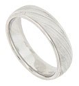 Diagonal stripes of impressed milgrain decoration adorns the surface of this 14K white gold mens wedding band