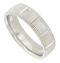 This mens wedding band is crafted of 14K white gold and softly rounded