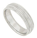 This 14K white gold mens wedding band has a satin finished central band framed by deeply impressed abstract florals