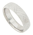Alternating triangles filled with zig-zaged engraving adorns the surface of this 14K white gold mens wedding band