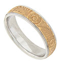 This distinctive 14K rose and white gold mens wedding band is embellished with detailed organic engraving
