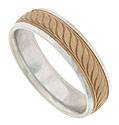 A repeating pattern of engraved curving leaves flanked by impressed milgrain adorns the face of this bi-color mens wedding band
