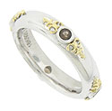 This elegant contemporary wedding band is fashioned of sterling silver, adorned with 18K yellow gold leaves