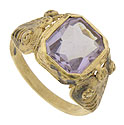 A breathtaking 2.75 carat rectangular amethyst is set into the face of this 14K yellow gold estate ring