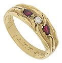 This estate wedding band features a rough hewn 14K yellow gold surface