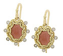 These phenomenal 14K yellow gold antique style earrings are set with oval cabuchon garnets