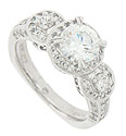This elegant 14K white gold antique style engagement ring mounting features a bold frame of round faceted diamonds with a total diamond weight of .63 carat
