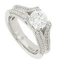 This dazzling 14K white gold engagement ring is designed with diamond encrusted forked shoulders