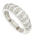 Columns of baguettes alternating with round faceted diamonds are set into this domed estate wedding band