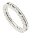 Engraved chevron designs decorate these slim 14K white gold antique style stackable wedding bands