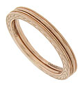 Chevron designs decorate the sides of these 14K red gold stackable wedding bands