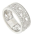 This exquisite 14K white gold wedding band is set with .85 carat total weight of round faceted diamonds