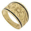This unique vintage wedding band is crafted of 14K yellow gold and framed with a band of black enamel