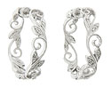 Delicate vines and twisting leaves set with round faceted diamonds form these 14K white gold earrings