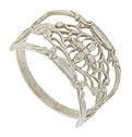 This elegant cigar-band style wedding ring is fashioned of 14K white gold and features a detailed organic filigree