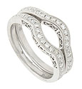 The sides of these 14K white gold curved wedding rings are decorated with looping figure-8 designs