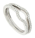 An indentation at the top of these 14K white gold stackable wedding bands allows them to be seamlessly worn with a diamond engagement ring