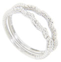 A spiraling rope pattern provides the ornamentation on these 14K white gold curved wedding bands