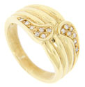 Mirrored designs frame a total of fourteen diamonds on this ridged estate 18K yellow gold estate wedding band