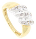 Three strips of diamonds set in white gold sparkle on top of this 18K yellow gold estate wedding band