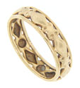 A cutout diamond pattern wraps around the circumference of this 9K yellow gold estate wedding band