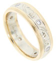 Glittering round diamonds are set at intervals around the circumference of this 14K gold estate wedding band