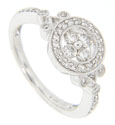 A diamond studded circle is the primary feature of this 14K white gold engagement ring