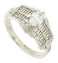 A dazzling .55 carat F color, Vs2 clarity marquise cut diamond is the focus of this spectacular antique style engagement ring