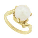 A luminous 9.45 mm pearl is set into the face of this vintage ring