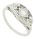 This splendid Art Deco engagement ring is set with .21 carat total weight of round faceted diamonds