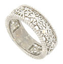 A brightly polished organic filigree surrounds the center of this 14K white gold wedding band