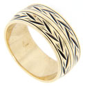 A double row of an angling leafy design decorates this 14K yellow gold vintage wedding band