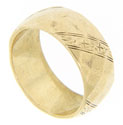 Diagonal floral designs serve as ornamentation on this 14K yellow gold vintage wedding band