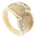 This 14K yellow gold vintage wedding band is set with curves of diamonds outside of delicate, detailed texturing