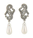 A teardrop shaped faux pearl dangles from these sterling silver and marcasite set earrings