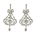 These sterling silver and marcasite dangle earrings are designed in a flowing and curved bow pattern
