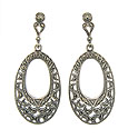 These lovely sterling silver and marcasite earrings are decorated with an intricate filigree and set on posts