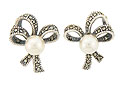 These lovely sterling silver and marcasite bridal earrings are fashioned into triple looped bows and set with a single luminous faux pearl