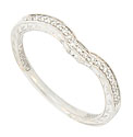 The squared off curves of this 14K white gold wedding band are set with round faceted diamonds