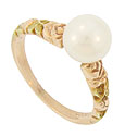 A luminous 7mm pearl glows from the center of this 14K red gold ring