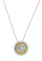 A brilliant round faceted blue topaz is the focus of this modern 10K yellow gold and sterling necklace