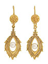 These elaborate vintage earrings are decorated with floral engraving and set with luminous pearls