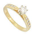 This exceptional 14K yellow gold engagement ring is set with a .27 carat H color, Si2 clarity round diamond