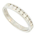 A row of fiery round cut diamonds are channel set in the face of this antique style wedding band