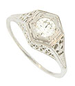 A glittering .43 carat, I color, Si2 clarity, round faceted diamond is set into the face of this antique style engagement ring