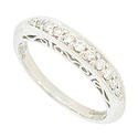 This elegant 14K white gold wedding band is brightly polished and set with a string of round faceted diamonds