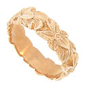 Deeply engraved flowers and leaves adorn the surface of this 14K rose gold antique style wedding band