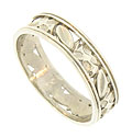 Large engraved flowers and leaves alternate across the face of this 14K white gold wedding band