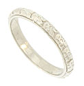 Large finely engraved florals cover the surface of this 14K white gold antique style wedding band