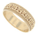 A repeating raised floral pattern provides decorative interest on this 14K yellow gold estate wedding band